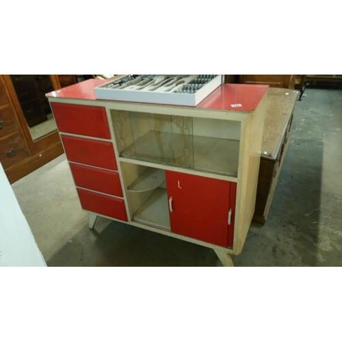 742 - A 1950's red and white kitchen unit with melamine top...