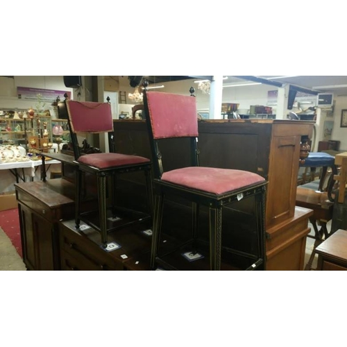 746 - A pair of ebonised chairs...
