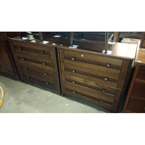747 - A pair of dark oak 4 drawer chests...