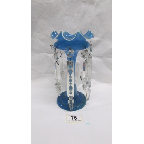 76 - A blue glass lustre vase with crystal droppers...