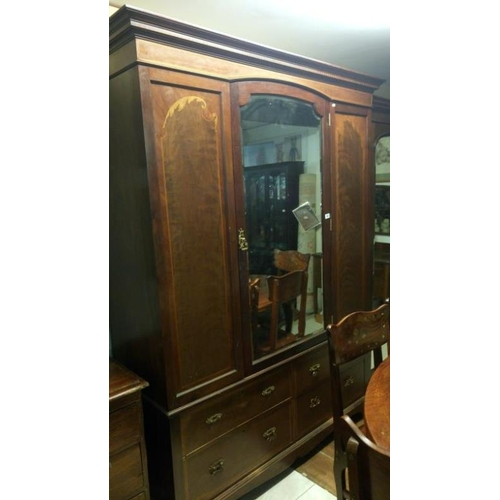 760 - A mahogany inlaid combination wardrobe...