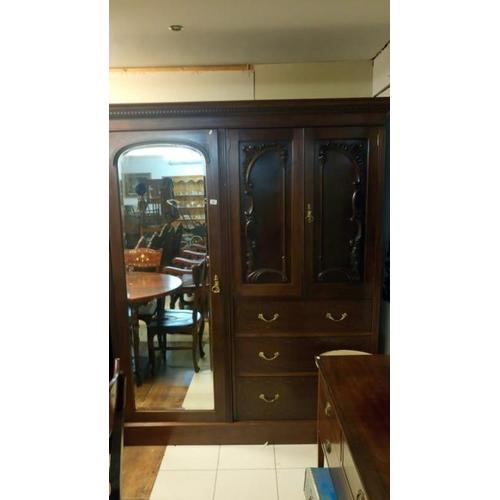761 - A mahogany combination wardrobe...