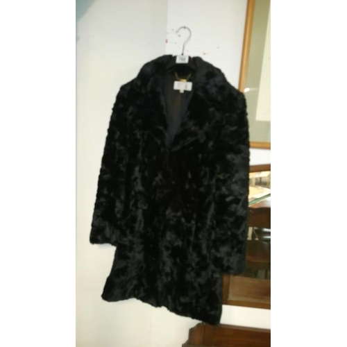 766 - A faux fur coat...