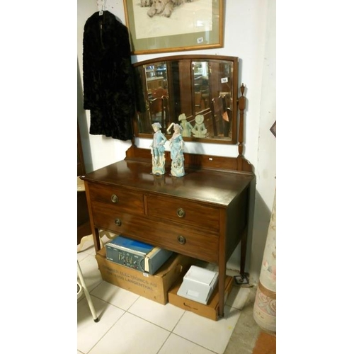 768 - A mahogany inlaid dressing table...