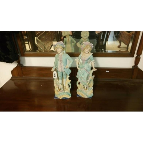 769 - A pair of continental bisque porcelain figures...