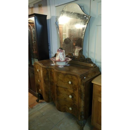 772 - A Victorian serpentine front walnut veneered mirror back 3 drawer chest...