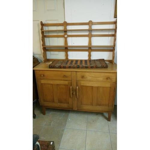 774 - An Ercol style teak dresser...