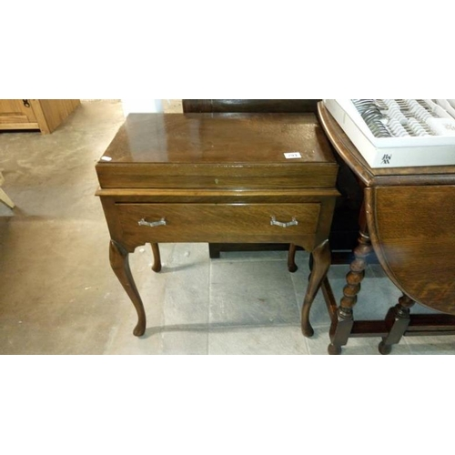 793 - A 1930's oak freestanding cutlery box on Queen Anne style legs (no contents)...