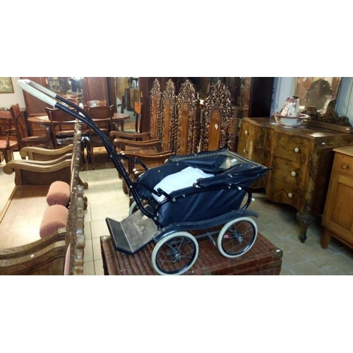 805 - A vintage Silver Cross push chair...