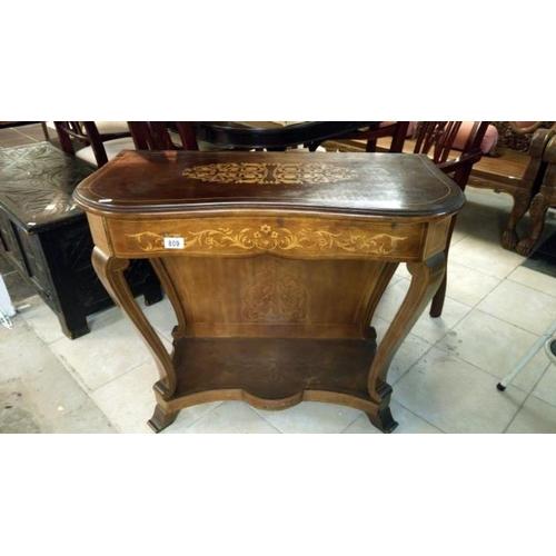 809 - A mahogany inlaid console table...