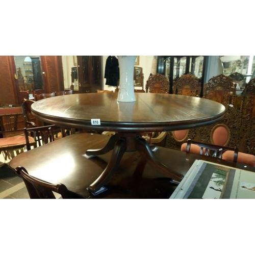 810 - A large circular mahogany coffee table...