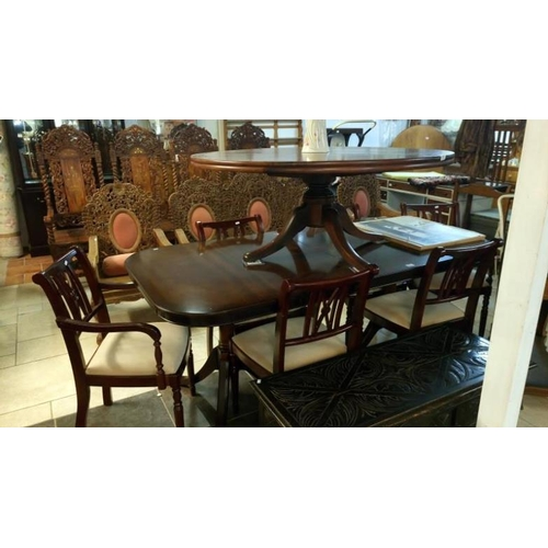 811 - A mahogany effect dining table and 4 chairs...