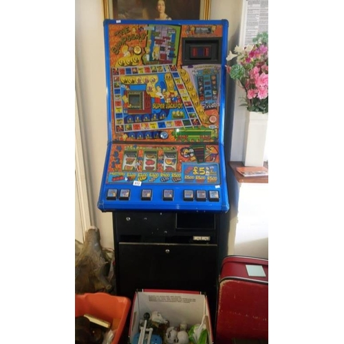 813 - A Simpson's arcade machine (works intermitantly)...