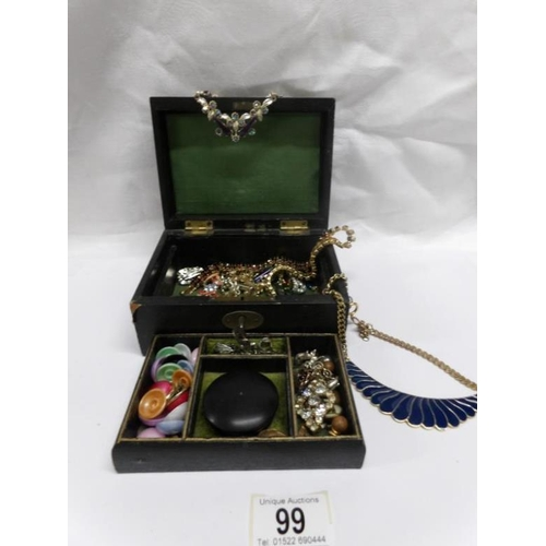 99 - A Victorian jewellery box and contents including necklaces, brooches etc...