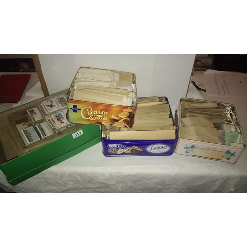 313 - A quantity of cigarette cards in albums and loose in 3 tins and a box...