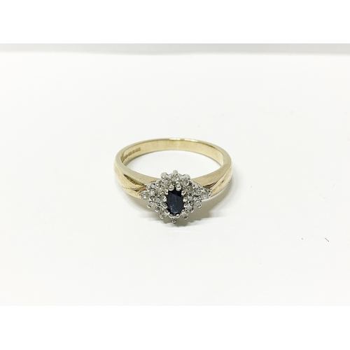 25 - A diamond and amethyst seven stone yellow gold ring, size N...
