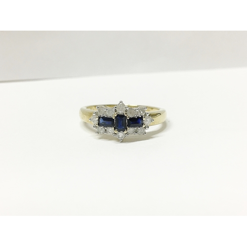 20 - A yellow gold baquette sapphire and diamond ring...