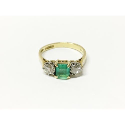 29 - An 18ct gold ring set with diamonds and emerald, size 0...