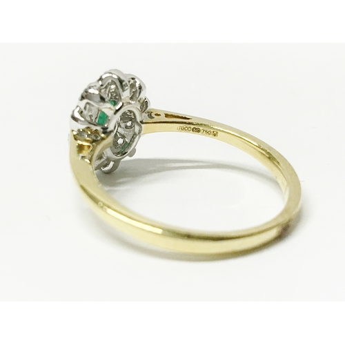 21 - A high carat yellow gold emerald and diamond ring, size 0...