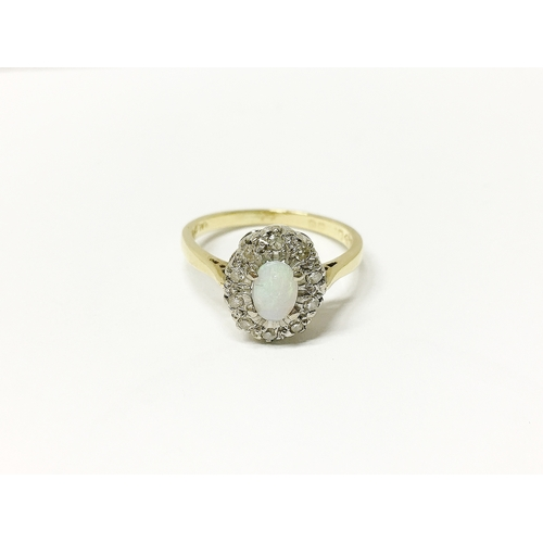 30 - An 18ct gold ring set with opal and diamond chips, size M...