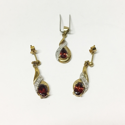 16 - A 9ct gold garnet pendant and earrings set...