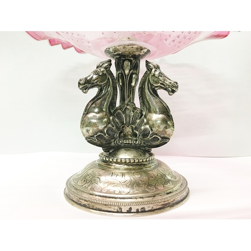 78 - A continental silver based comport with 3 horse heads and cranberry glass dish...