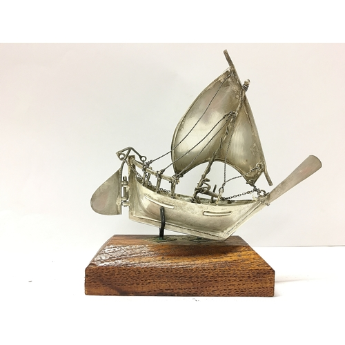 159 - An unmarked continental silver model of a sailing boat...