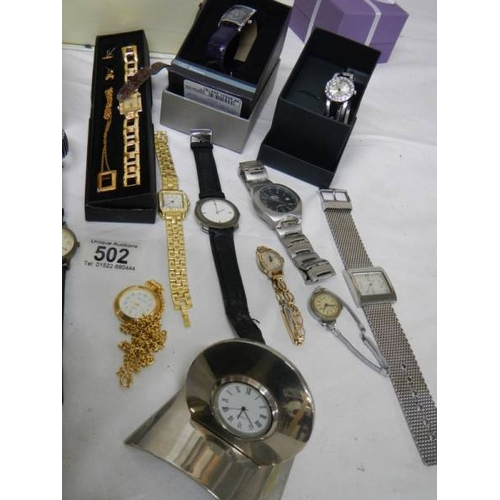 502 - A good lot of Ladies and Gents watches including a 2 piece clock....