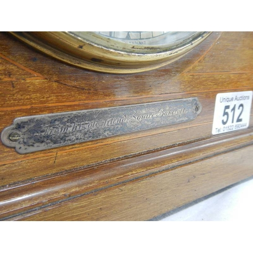 512 - A mahogany mantel clock with key (springs ok)....