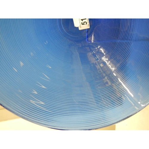 517 - A 40 cm diameter blue glass bowl and other blue glass ware....
