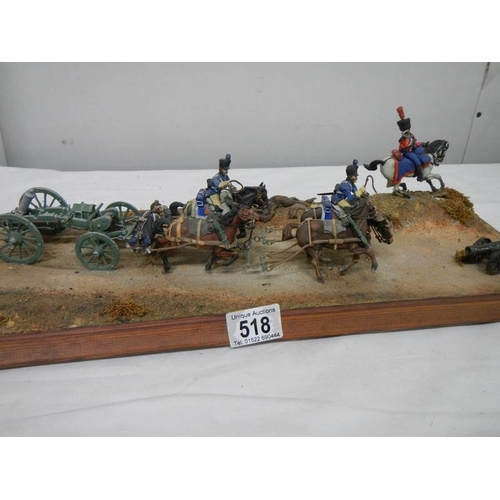 518 - A diorama featuring 4 horses pulling a cannon and soldiers on horseback....