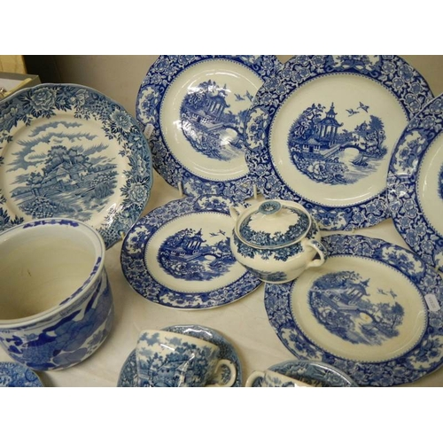521 - A large quantity of old blue and white china including Spode Italian, Old Alton ware etc.,...