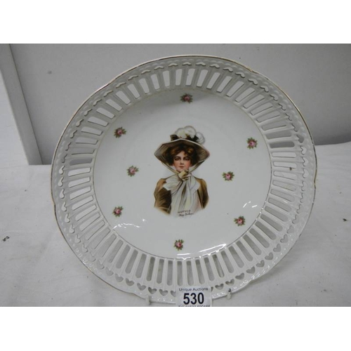 530 - A hand painted and signed dish, 26cm diameter, in good condition....