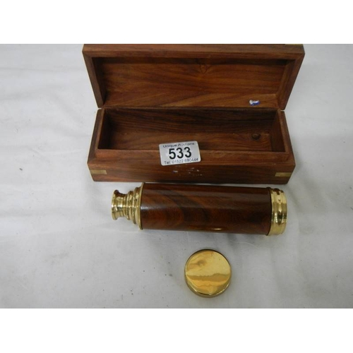 533 - A 3 draw brass telescope in wooden case with brass plaque reading Towe of London, in very good condi...