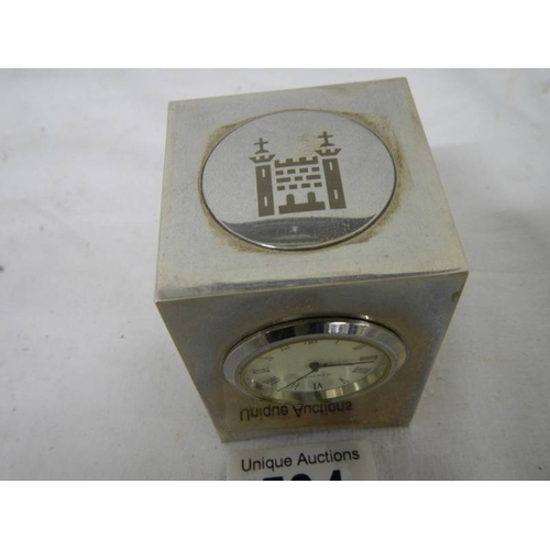 534 - A small three sided clock/thermometer/hydrometer, 7 cm tall....