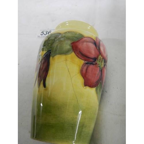 536 - A Moorcroft vase, 13 cm, unfortunately badly cracked (see images)....