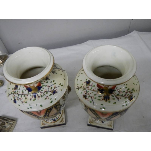 537 - A pair of Crown Derby style vases (heavily restored)....