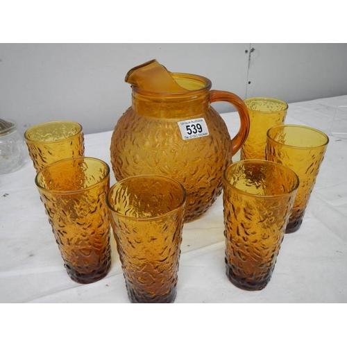 539 - An amber coloured mid 20th century glass lemonade set....