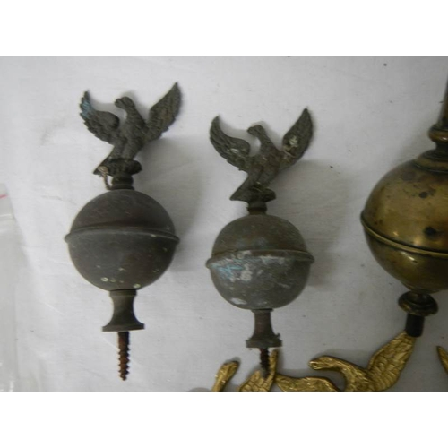 544 - A quantity of 19/20th century brass grandfather clock hood finials including 3 new reproduction exam...