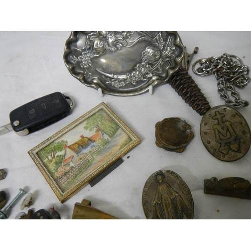 551 - An old tin and contents including bank notes, art nouveau pin tray etc.,...