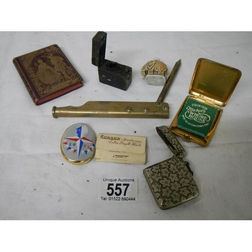 557 - A mixed lot including silver plate vesta case, match holder, elephant scent bottle etc.,...