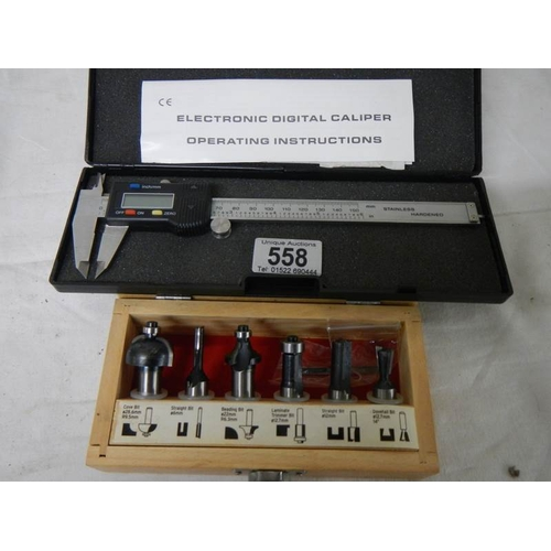 558 - An electronic digital calliper and a set of 6 new router bits.