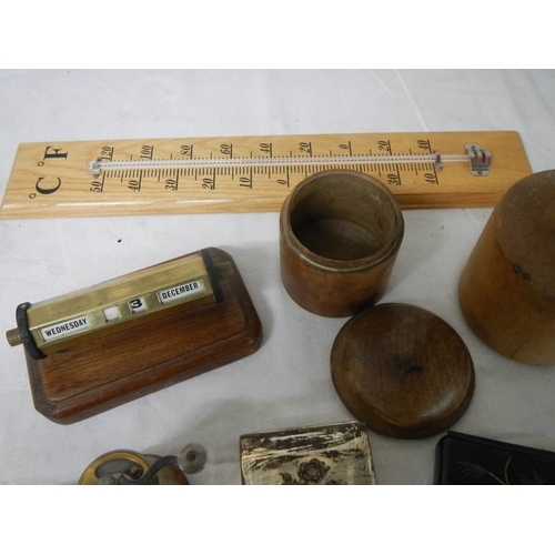 559 - A mixed lot including match holder, perpetual calendar, thermometer, etc.,...