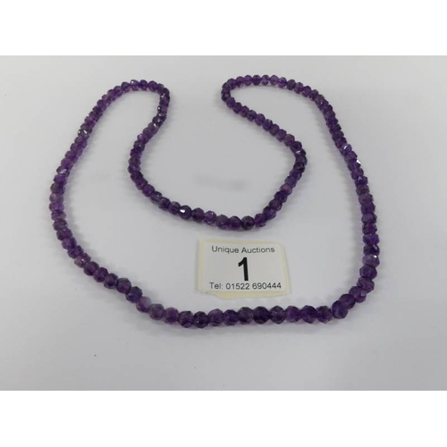 1 - A natural amethyst long necklace....