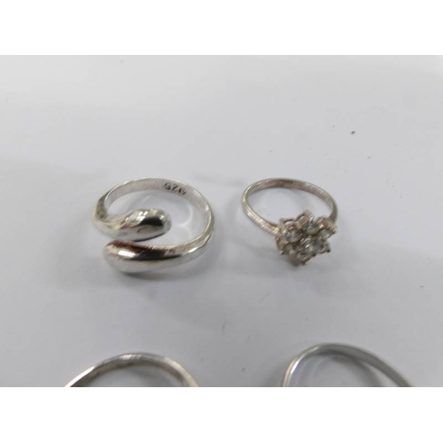 12 - Six silver rings including a Claddagh ring....