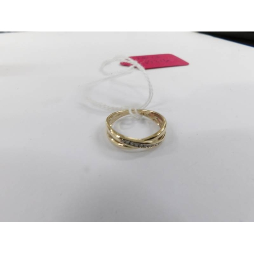 13 - A diamond twist ring in 9ct gold....