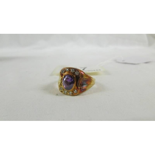 17 - An 18ct gold ring set amethyst coloured stone, size T....