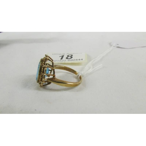 18 - A 9ct gold ring set large blue stone, size T....