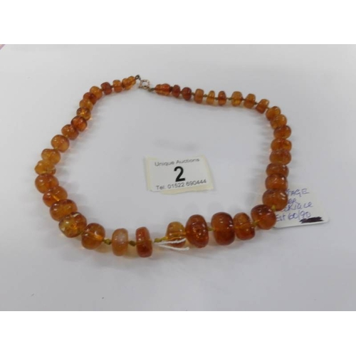 2 - A vintage amber necklace....