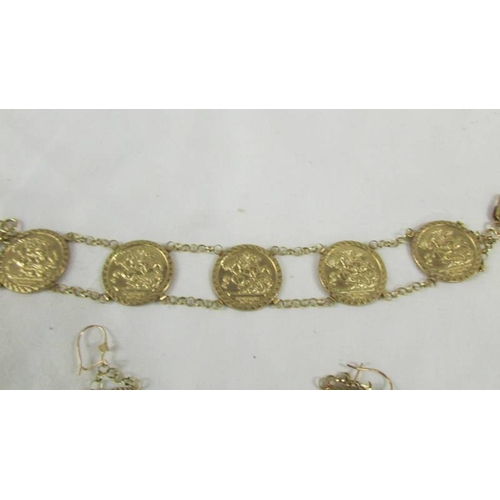 20 - A 9ct gold bracelet with 5 St. George medallions and a matching pair of pendant earrings. 12.5 grams...
